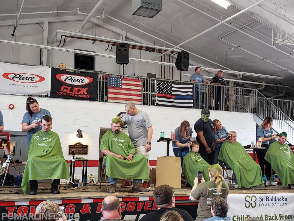 Fireifghter/EMT Shawn Anderson from The Singerly Fire Conpany being shaved by Chief Griffith joined on stage by members from the Singerly Fire Company in Cecil County Maryland.