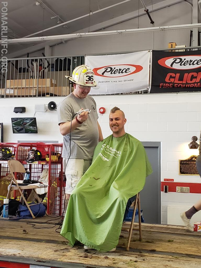 Captain Abel getting his head shaved.