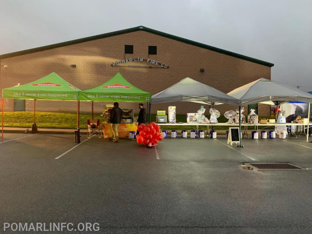 Servpro with our Raffle Tents.